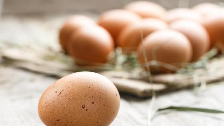 fresh organic farm eggs lie on burlap, on a wooden background
