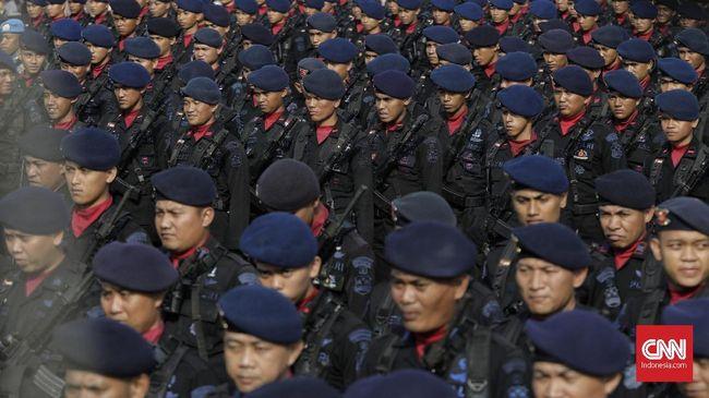 Upacara puncak perayaan HUT ke-73 Bhayangkara di Silang Monas, Jakarta, Rabu. 10 Juli 2019. Presiden mengapresiasi atas pencapaian Wajar Tanpa Pengecualian (WTP) dari BPK serta berharap sinergitas TNI - Polri dapat ditingkatkan dalam upaya menghadapi berbagai tantangan tugas yang semakin kompleks. CNN Indonesia/Adhi Wicaksono