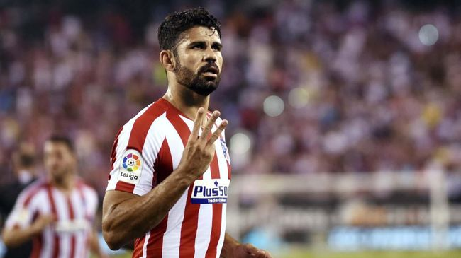 Atletico Madrid's Diego Costa celebrates after scoring his third goal during the 2019 International Champions Cup football match between Real Madrid and Atletico Madrid at the Metlife Stadium Arena in East Rutherford, New Jersey on July 26, 2019. (Photo by Johannes EISELE / AFP)