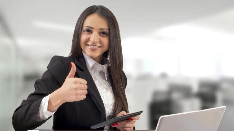 Multi-tasking succesfull businesswoman in office interior
