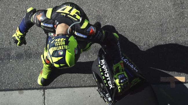 Italian rider Valentino Rossi of the Monster Energy Yamaha MotoGP walks in the pit lane during a warm up session for the MotoGP race at the Czech Republic motorcycle Grand Prix at the Automotodrom Brno, in Brno, Czech Republic, Sunday, Aug. 4, 2019. (AP Photo/Petr David Josek)