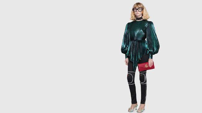 Gucci menuai hujatan karena koleksi aksesori anehnya yang dijual dengan harga mahal.