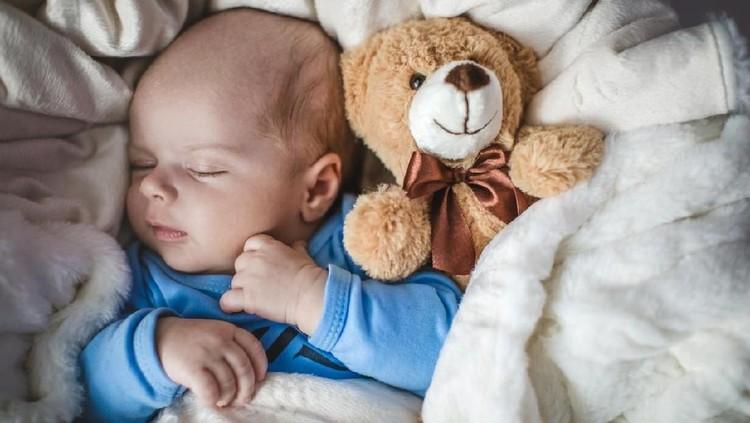 Newborn baby boy laying in crib