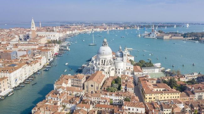 Aerial of the stunning Venice skyline with the most famous tourist attractions and the Veleziana Regatta in back. Converted from RAW.