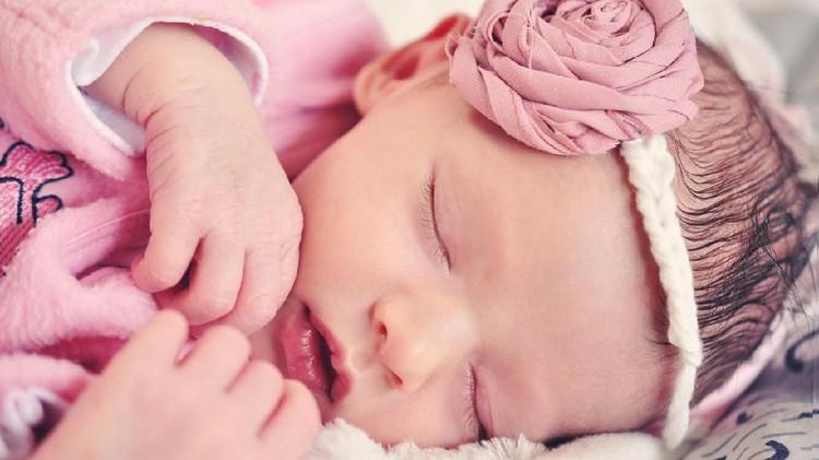 Newborn Beautiful Little Girl Sleeping On a Bed
