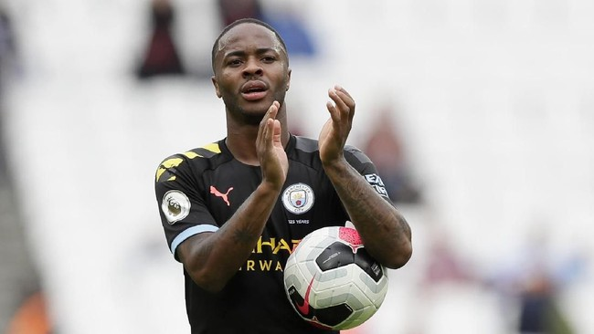 Manchester City's Raheem Sterling applauds at the end of the English Premier League soccer match between West Ham United and Manchester City at London stadium in London, Saturday, Aug. 10, 2019. Sterling scored three goals in Manchester City's 5-0 win. (AP Photo/Kirsty Wigglesworth)