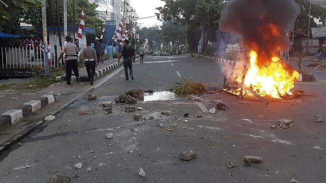 Demo digelar di Wamena, Jayawijaya, Papua diikuti para pelajar, Senin (23/9). Demo berujung rusuh dan Kantor Bupati Jayawijaya terbakar.