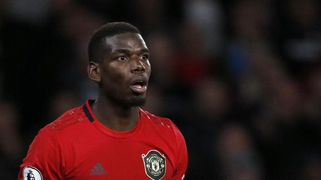 Manchester United's Paul Pogba reacts during the English Premier League soccer match between Wolverhampton Wanderers and Manchester United at the Molineux Stadium in Wolverhampton, England, Monday, Aug. 19, 2019. (AP Photo/Rui Vieira)