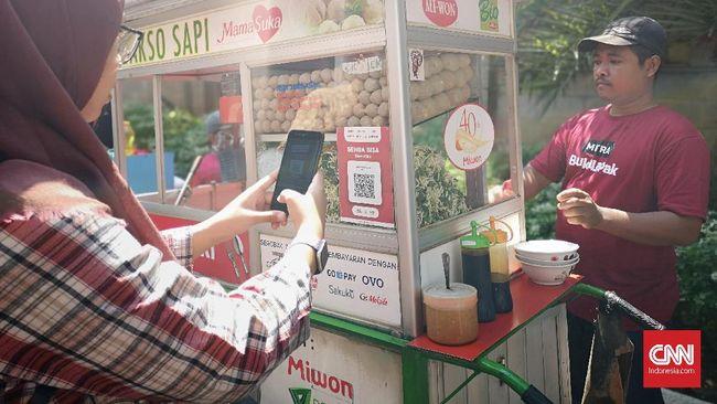 Bank Indonesia menyatakan maraknya transaksi pembayaran berbasis digital tidak akan menghentikan peredaran uang logam dan kertas.