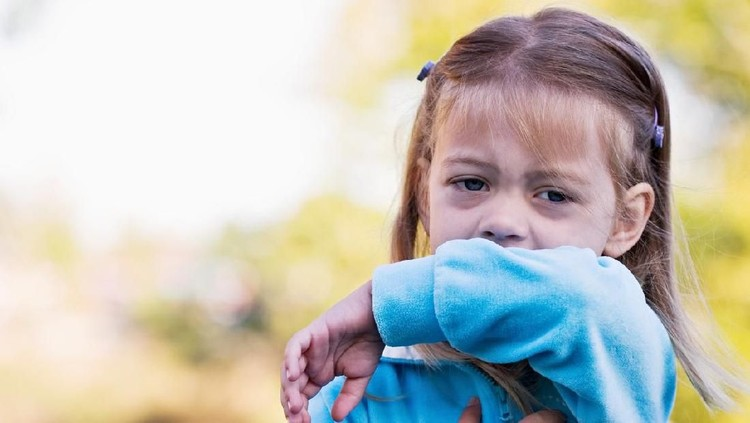 This sweet little girl shows the viewer the correct way to sneeze or cough by using the inside of her elbow and not her hands.