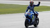 Spain's rider Alex Rins of the Team SUZUKI ECSTAR celebrates after winning the MotoGP race at the British Motorcycle Grand Prix at the Silverstone racetrack, in Silverstone, England, Sunday, Aug. 25, 2019. (AP Photo/Rui Vieira)