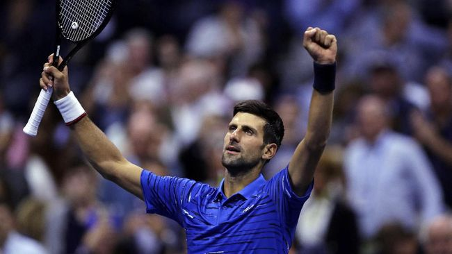 Novak Djokovic, of Serbia, raises his arms after defeating Juan Ignacio Londero, of Argentina, during the second round of the U.S. Open tennis tournament in New York, Wednesday, Aug. 28, 2019. (AP Photo/Charles Krupa)