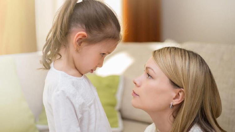 Beautiful mother is comforting her sad little daughter at home. Family relationships.