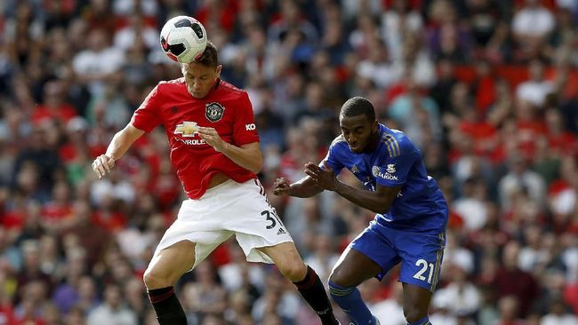 Manchester United's Nemanja Matic, left, and Leicester City's Ricardo Pereira jump for the ball during the English Premier League soccer match between Manchester United and Leicester City at Old Trafford Stadium, Manchester England. Saturday, Sept. 14 2019 (Martin Rickett/PA via AP)