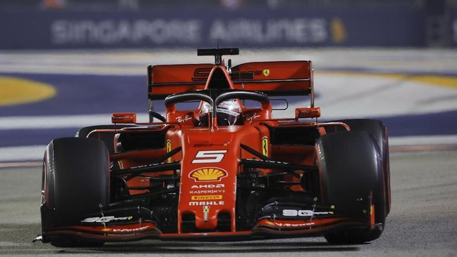 Ferrari driver Sebastian Vettel of Germany steers his car during the Singapore Formula One Grand Prix, at the Marina Bay City Circuit in Singapore, Sunday, Sept. 22, 2019. (AP Photo/Vincent Thian)