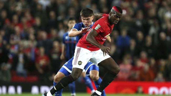 Manchester United harus melalui babak adu penalti untuk mengalahkan Rochdale pada babak ketiga Piala Liga Inggris di Stadion Old Trafford, Kamis (26/9) WIB.