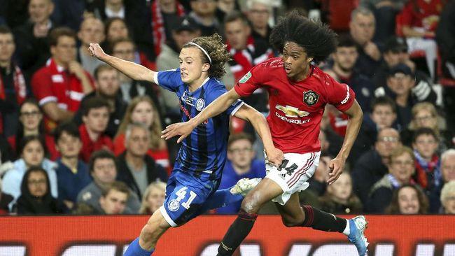 Manchester United butuh waktu lebih dari 90 menit untuk menuntaskan perlawanan klub divisi tiga, Rochdale, dalam babak ketiga Piala Liga Inggris.