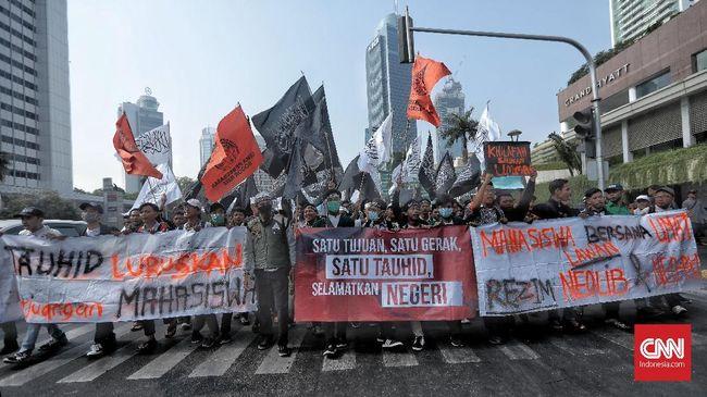 Ratusan orang yang mengikuti Aksi Mujahid 212 menyarakan penolakan pada RKUHP serta menuntut Presiden Jokowi mundur.