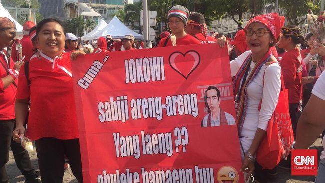 Massa 'Kami Bersama Jokowi' khawatir aksi yang digelar dalam sepekan terakhir ditunggangi kelompok lain sehingga berujung rusuh.