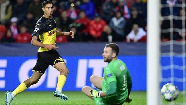 Borussia Dortmund menuai kemenangan 2-0 atas Slavia Praha pada matchday kedua Liga Champions, sementara Napoli hanya bermain imbang tanpa gol lawan Genk.