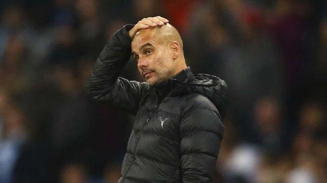 Pelatih Man City Pep Guardiola lolos dari sanksi FA meski diduga sarkasme kepada wasit usai kalah 1-3 dari Liverpool di Liga Inggris.