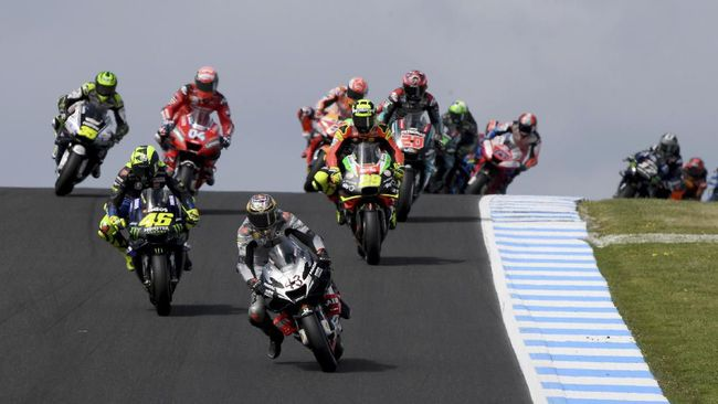 MotoGP Ducati rider Jack Miller (43) of Australia leads the field out of a turn during the Motorcycle Grand Prix at Phillip Island near Melbourne, Australia, Sunday, Oct. 27, 2019. (AP Photo/Andy Brownbill)