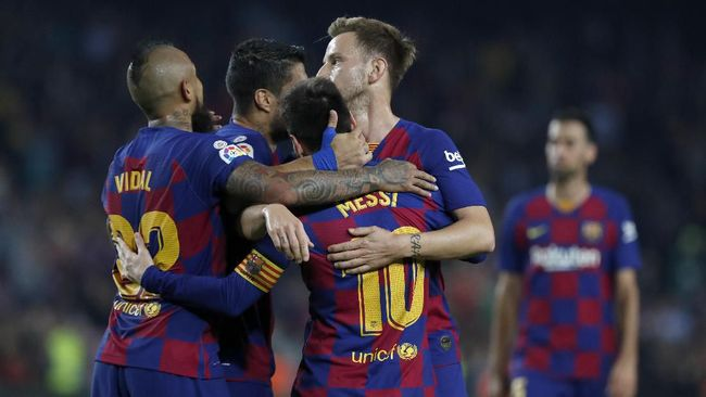 Barcelona's Lionel Messi and teammates celebrate a goal during the Spanish La Liga soccer match between FC Barcelona and Valladolid CF at the Camp Nou stadium in Barcelona, Spain, Tuesday, Oct. 29, 2019. (AP Photo/Joan Monfort)