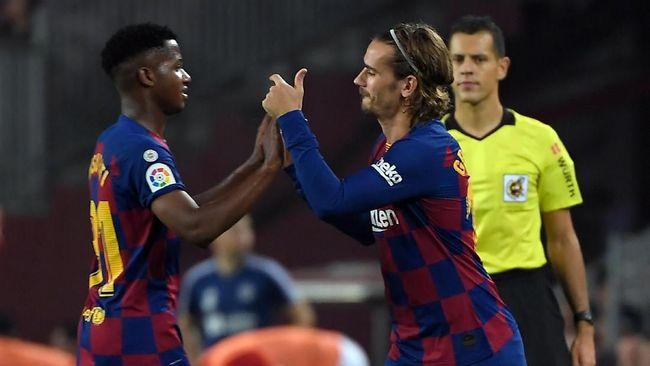 Para fan Barcelona di media sosial menganggap Antoine Griezmann diabaikan Lionel Messi dan Luis Suarez.