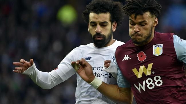Liverpool's Mohamed Salah, left, duels for the ball with Aston Villa's Tyrone Mings during the English Premier League soccer match between Aston Villa and Liverpool at Villa Park in Birmingham, England, Saturday, Nov. 2, 2019. (AP Photo/Rui Vieira)