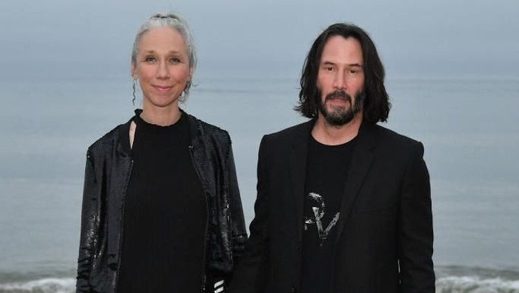 MALIBU, CALIFORNIA - JUNE 06: (L-R)  Alexandra Grant and Keanu Reeves attend the Saint Laurent Mens Spring Summer 20 Show Photo Call on June 06, 2019 in Malibu, California. (Photo by Neilson Barnard/Getty Images)