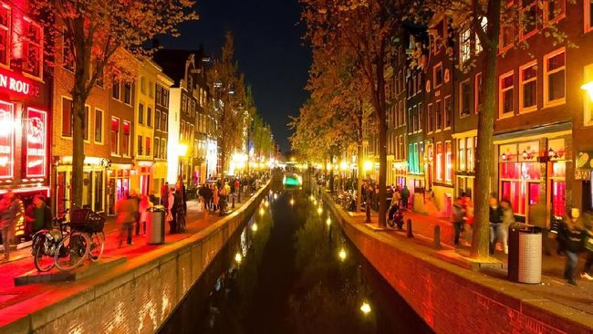 Amsterdam, the Netherlands-May 01,2015: Red light district (Wallen) at night, crowd of people on the street in Amsterdam, the Netherlands.