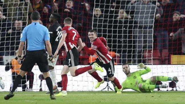 Manajer MU Ole Gunnar Solskjaer menyatakan jika bisa ingin mengganti 11 pemain di babak pertama usai The Red Devils ditahan imbang Sheffield United 3-3.