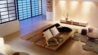<div>Ruang tamu ini menggunakan alas duduk berbentuk seperti batu. Sehingga, ruang tamu tanpa sofa yang satu ini terlihat lebih alami. (Foto: Instagram @desainbangun.official)</div><div></div>