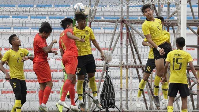 Meski menang telak atas Timor Leste, timnas Malaysia masih dalam ancaman tak lolos ke semifinal SEA Games 2019.