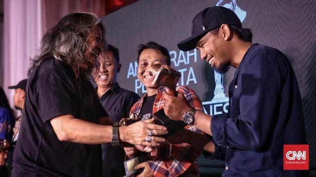 Pewarta foto CNNIndonesia.com, Adhi Wicaksono, berhasil meraih juara I kompetisi foto nasional AFPI 2019.
