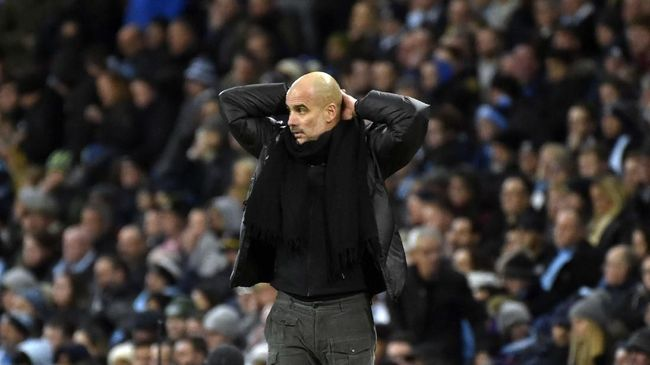 Manchester City's head coach Pep Guardiola reacts during the English Premier League soccer match between Manchester City and Manchester United at Etihad stadium in Manchester, England, Saturday, Dec. 7, 2019. (AP Photo/Rui Vieira)