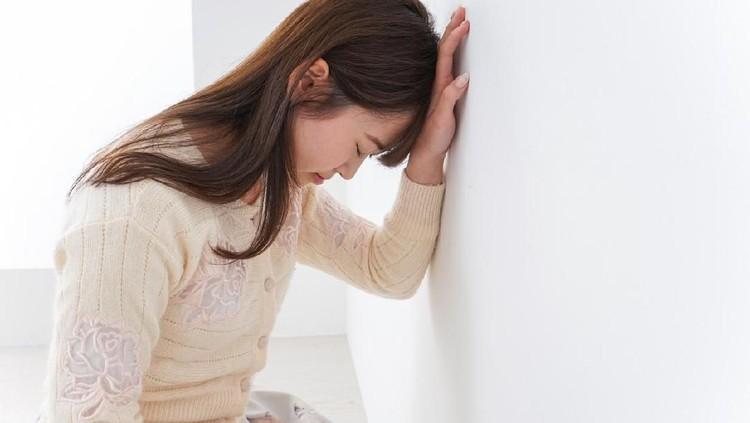 Young woman suffer from illness