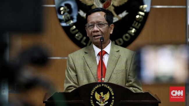 Menko Polhukam Mahfud MD saat menyampaikan Keterangan Pers terkait Penegakan Hukum dan Pemberantasan Korupsi. Jakarta. Kamis (12/12/2019).CNN Indonesia/Andry Novelino