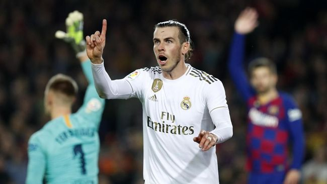 Real Madrid's Gareth Bale reacts during a Spanish La Liga soccer match between Barcelona and Real Madrid at Camp Nou stadium in Barcelona, Spain, Wednesday, Dec. 18, 2019. Thousands of Catalan separatists are planning to protest around and inside Barcelona's Camp Nou Stadium during Wednesday's