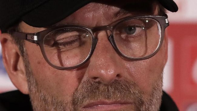 Liverpool's manager Jurgen Klopp speaks during a press conference in Doha, Qatar, Friday, Dec. 20, 2019. Liverpool will play the Club World Cup final soccer match against Flamengo in Doha on December 21. (AP Photo/Hassan Ammar)