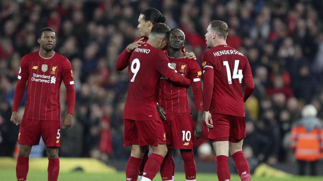 Liverpool's Sadio Mane, 2nd right, celebrates after scoring the opening goal during the English Premier League soccer match between Liverpool and Wolverhampton Wanderers at Anfield Stadium, Liverpool, England, Sunday Dec. 29, 2019. (AP Photo/Jon Super)