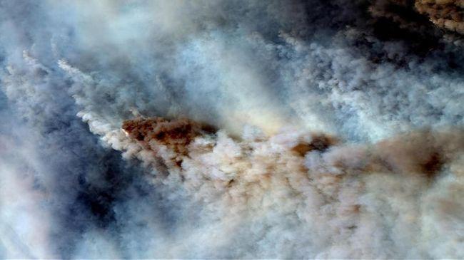 Sejumlah kawasan di Australia termasuk Canberra dan Melbourne kini tengah mengalami hujan es hingga badai debu usai bencana kebakaran hutan.