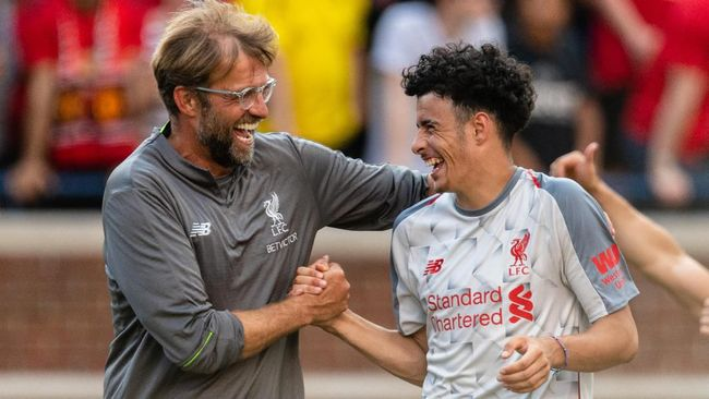 ANN ARBOR, MI - JULY 28: Head coach Jurgen Klopp celebrates with Curtis Jones #48 after Liverpool defeated Manchester United during second half of the International Champions Cup 2018 at Michigan Stadium on July 28, 2018 in Ann Arbor, Michigan. Liverpool defeated Manchester United 4-1.   Jason Miller/Getty Images/AFP