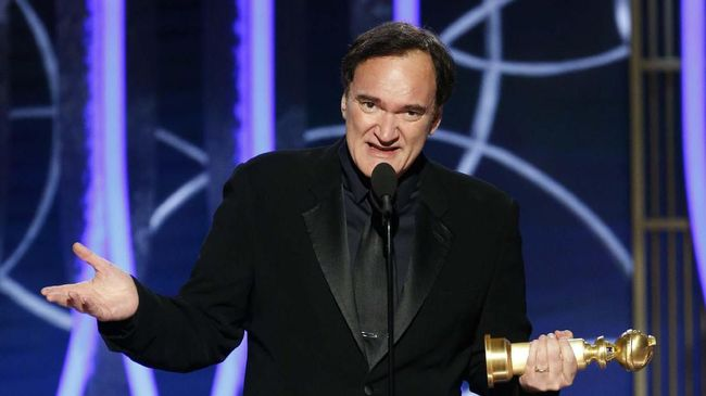 This image released by NBC shows Quentin Tarantino accepting the award for best screenplay for
