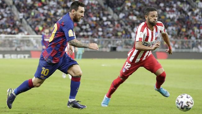 Barcelona's Lionel Messi, left, fights for the ball with Atletico Madrid's Renan Lodi during the Spanish Super Cup semifinal soccer match between Barcelona and Atletico Madrid at King Abdullah stadium in Jiddah, Saudi Arabia, Thursday, Jan. 9, 2020. (AP Photo/Hassan Ammar)