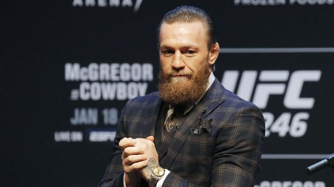 Conor McGregor motions to the crowd during a news conference for a UFC 246 mixed martial arts bout, Wednesday, Jan. 15, 2020, in Las Vegas. McGregor is scheduled to fight Donald