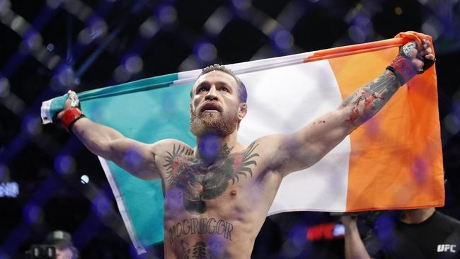 Conor McGregor celebrates after defeating Donald