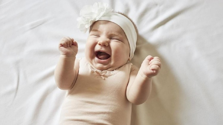 Cute little baby girl laughing