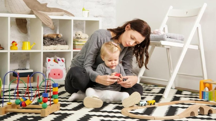 Mom and her baby girl spending time together in the nursery room