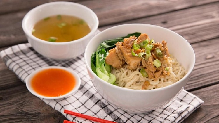 mie or bakmi ayam. seasoned yellow wheat noodles topped with diced chicken meat